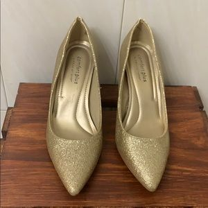 Gold glitter shoes.